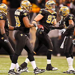 January 2, 2011; New Orleans, LA, USA; New Orleans Saints defensive end Jeff Charleston (97) celebrates with teammates following a fumble recovery against the Tampa Bay Buccaneers during the second quarter at the Louisiana Superdome. Mandatory Credit: Derick E. Hingle