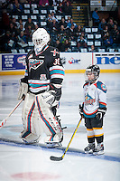 KELOWNA, CANADA - NOVEMBER 20: The Pepsi Save On Foods player of the game lines up beside Michael Herringer #30 of Kelowna Rockets against the Edmonton Oil Kings on November 20, 2015 at Prospera Place in Kelowna, British Columbia, Canada.  (Photo by Marissa Baecker/ShoottheBreeze)  *** Local Caption *** Michael Herringer; Pepsi player;