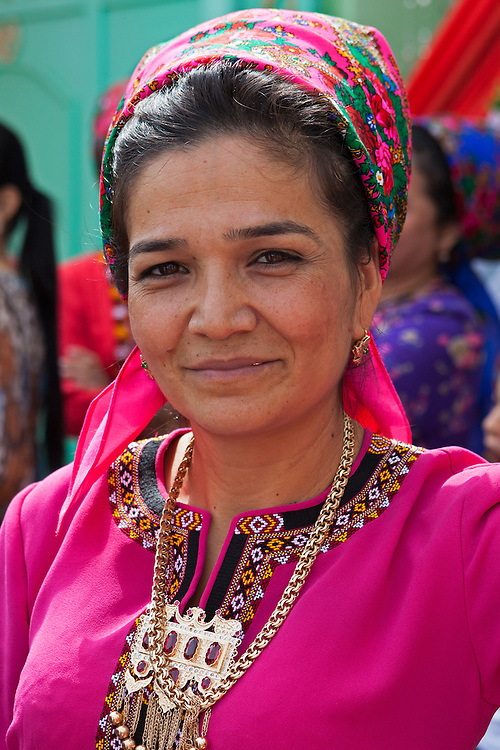 Local woman in traditional dress and scarf, Ashgabat, Turkmenistan
