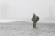 An angler, Steve Warmann, fly fishes during a snow storm on the South Fork of the Snake River, Idaho.