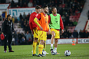 Steven Gerrard Adam Lallana and Lucas Leiva warming up before the Bournemouth v Liverpool Capital One Cup quarter final at the Goldsands Stadium, Bournemouth on 17th December 2014.