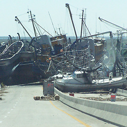 Scenes of devastation left in the aftermath of Hurricane Katrina that flooded the small city of Buras, Louisiana in Plaquemines Parish  on August 29, 2005. Boats are piled up at the base of the Empire Bridge like toys by Katrina's floodwaters...(Mandatory Credit: Photo by Derick E. Hingle)