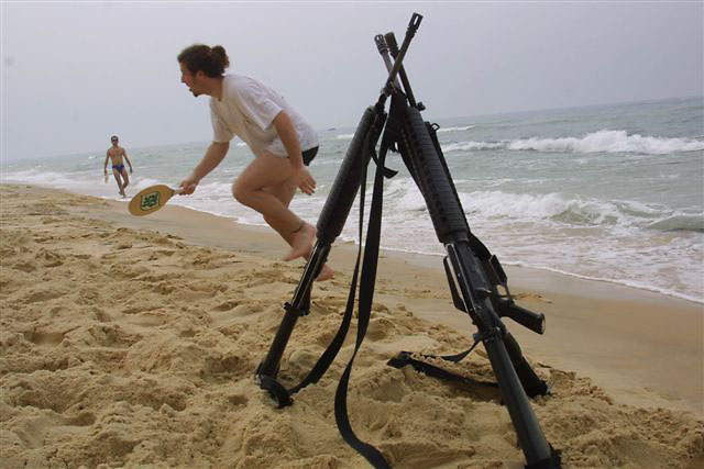 Israelis on the beach in gosh Ktif Gaza strip near their  M16 Colt gun...22 August 2004
