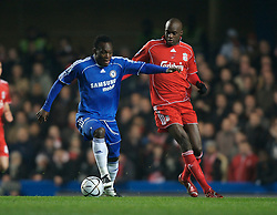 LONDON, ENGLAND - Wednesday, December 19, 2007: Liverpool's Momo Sissoko and Chelsea's Michael Essien during the League Cup Quarter Final match at Stamford Bridge. (Photo by David Rawcliffe/Propaganda)