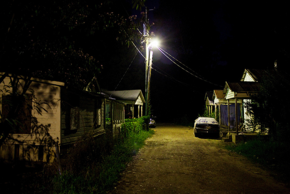 A neglected alleyway at night in the Baptist Town neighborhood of Greenwood, Mississippi on Saturday, July 3, 2010.