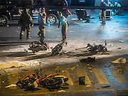 Aug. 17, 2015 - Bangkok, Thailand - <br /> <br /> Huge Explosion Rocks Bangkok Landmark<br /> <br /> Thai police and bomb squad officers at the scene of an explosion Monday at Erawan Shrine. An explosion at Erawan Shrine, a popular tourist attraction and important religious shrine, in the heart of the Bangkok shopping district killed at least 19 people and injured more than 120 others, mostly foreign tourists, during the Monday evening rush hour. Twelve of the dead were killed at the scene. Thai police said an Improvised Explosive Device (IED) was detonated at 18.55. Police said the bomb was made of more than six pounds of TNT stuffed in a pipe and wrapped with white cloth. Its destructive radius was estimated at 100 meters. The Bangkok government announced that public schools would be closed Tuesday as a precaution.<br /> ©Exclusivepix Media