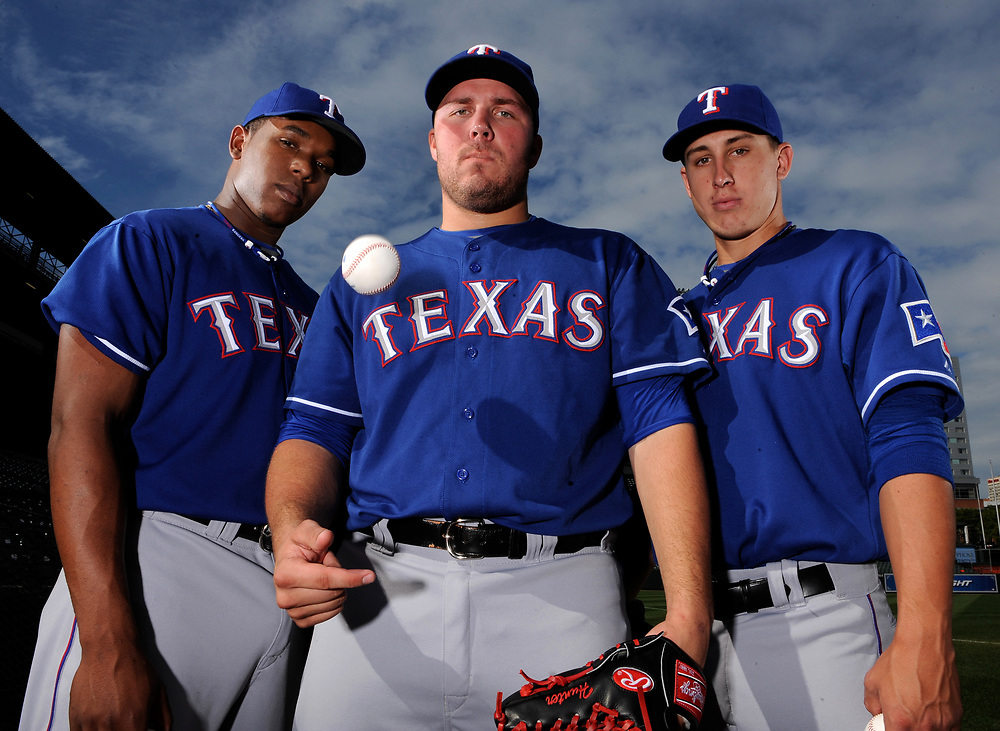 9/4/09 3:44:11 PM -- Baltimore, MD, U.S.A -- Texas Rangers rookie pitchers Neftali Feliz, left, Tommy Hunter and Derek Holland.   Photo by H. Darr Beiser, USA TODAY Staff  ORG XMIT: HB 36968 RANGERS PITCHERS 9/4/20 (Via MerlinFTP Drop)