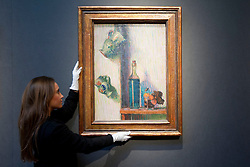 "© Licensed to London News Pictures. 18/11/2013. London, UK. A member of Christie's staff adjusts ""Flowers, Bottle and Two Jugs"" (est. GB£250,000 - 350,000), painted by Irish artist Roderic O'Conner in around 1892, at the press view for a sale of modern British and Irish art at Christie's St James' auction house in London today (18/11/2013). The sale is set to take place on Wednesday the 20th and Thursday the 21st of November 2013. Photo credit: Matt Cetti-Roberts/LNP"