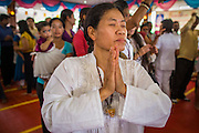 "29 SEPTEMBER 2012 - NAKORN NAYOK, THAILAND:  Thai Buddhists pray and seek the blessings of Ganesh during observances of Ganesh Ustav at Wat Utthayan Ganesh, a temple dedicated to Ganesh in Nakorn Nayok, about three hours from Bangkok. Many Thai Buddhists incorporate Hindu elements, including worship of Ganesh into their spiritual life. Ganesha Chaturthi also known as Vinayaka Chaturthi, is the Hindu festival celebrated on the day of the re-birth of Lord Ganesha, the son of Shiva and Parvati. The festival, also known as Ganeshotsav (""festival of Ganesha"") is observed in the Hindu calendar month of Bhaadrapada, starting on the the fourth day of the waxing moon. The festival lasts for 10 days, ending on the fourteenth day of the waxing moon. Outside India, it is celebrated widely in Nepal and by Hindus in the United States, Canada, Mauritius, Singapore, Thailand, Cambodia, Burma , Fiji and Trinidad & Tobago.     PHOTO BY JACK KURTZ"