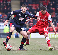 Picture by David Horn/Focus Images Ltd +44 7545 970036.23/02/2013.Lloyd James of Leyton Orient is held off by Jamie Proctor of Crawley Town during the npower League 1 match at the Matchroom Stadium, London.