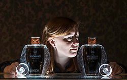 The Bonhams Whisky Auction will take place on 9 October 2019. Amongst the lots will be two bottles of Macallan Lalique 50 year old. The first of The Lalique Six Pillars Collection of the distillery's rarest single malts, released between 2006-2016. They are estimated to fetch £67,000-93,000 each.  Pictured: Georgina Porteous, Junior Whisky Specialist at the Bonhams Whisky Auction.