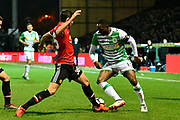 Francois Zoko (13) of Yeovil Town takes on Matteo Darmian (36) of Manchester United during the The FA Cup 4th round match between Yeovil Town and Manchester United at Huish Park, Yeovil, England on 26 January 2018. Photo by Graham Hunt.
