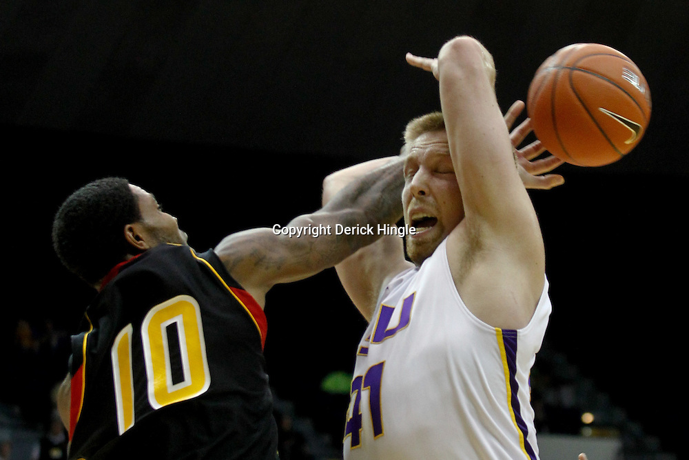December 29, 2011; Baton Rouge, LA; Grambling State Tigers guard Quincy Roberts (10) knocks the ball away from LSU Tigers center Justin Hamilton (41) during the first half of a game at the Pete Maravich Assembly Center.  LSU defeated Grambling State 69-37. Mandatory Credit: Derick E. Hingle-US PRESSWIRE