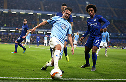 Malmo's Andreas Vindheim (left) and Chelsea's Willian (right) battle for the ball