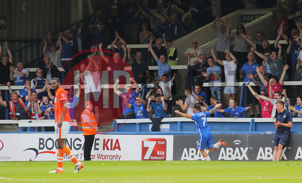 Jon Taylor of Peterborough United celebrates scoring his hat-trick goal in front of jubilant Peterborough fans- Mandatory by-line: Joe Dent/JMP - 08/05/2016 - FOOTBALL - ABAX Stadium - Peterborough, England - Peterborough United v Blackpool - Sky Bet League One