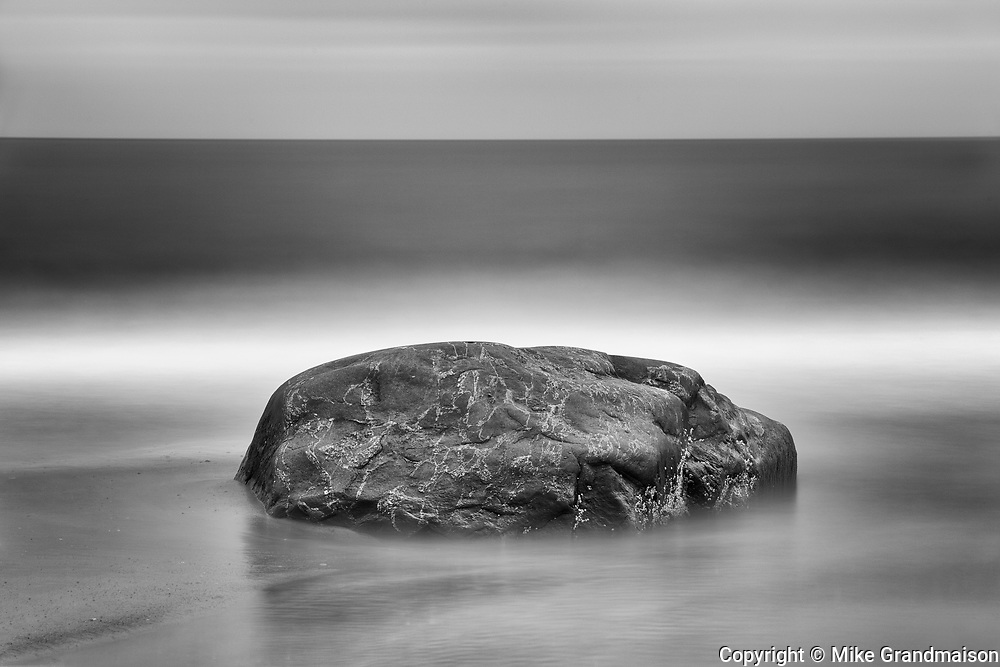 Long exposure of ocean crashing against rock along the North Shore of the Gulf of St. Lawrence<br />