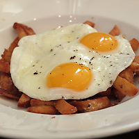 Where else could you find fried eggs on top of French fries but Chicago? This plate comes from Publican Quality Meats restaurant.