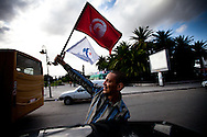 october 21, 2011 – Tunis, Tunisia – Supporters of the Islamist Ennahda party drive through the strets of Tunis on the last day of campaigning. Ten months since the uprising forced the resignation of President Zine el Abidine Ben Ali, 81 political parties, as well as hundreds of independent candidates, are slated to compete in an election to be held October 23. The election will send 217 Tunisians to serve in the constituent assembly, which will rewrite the country's constitution and appoint a new government.