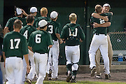Ed Essig gets a hug from his coach after hitting a homerun during the opening round of the Mid-Atlantic Senior League regional tournament held in West Deptford on Friday, August 5.