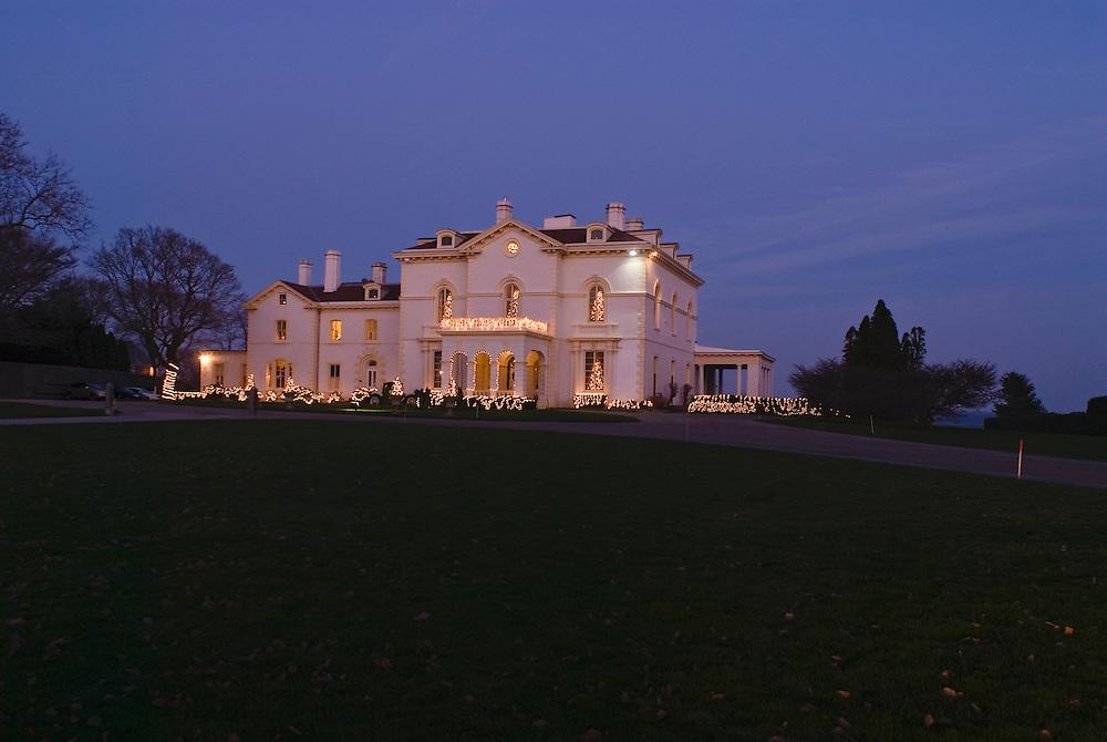 Rhode Island, Newport, Mansion lit up, dusk Christmas