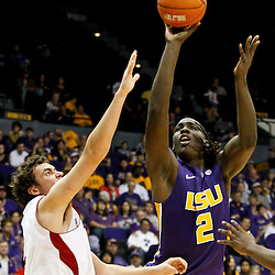 November 12, 2011; Baton Rouge, LA; LSU Tigers forward Johnny O'Bryant (2) shoots over Nicholls State Colonels forward Lachlan Prest (2) during the second half of a game at the Pete Maravich Assembly Center. LSU defeated Nicholls State 96-74.  Mandatory Credit: Derick E. Hingle-US PRESSWIRE