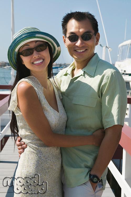 Couple Hugging on Pier