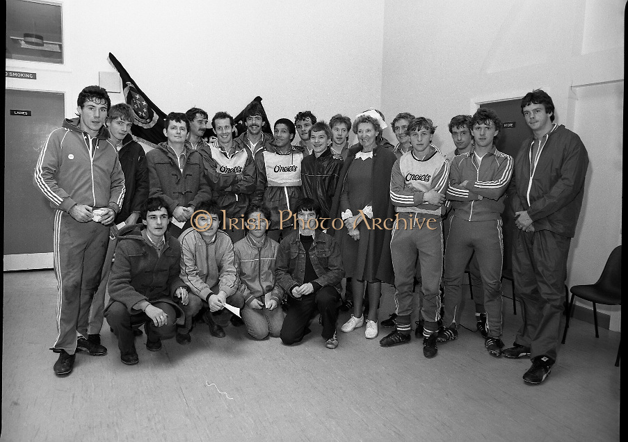 Ireland Soccer Team Training.1983.14.11.1983.11.14.1983.14th November 1983..The Ireland Soccer team trained, for the forthcoming match against Malta, at Stewarts Hospital,Palmerstown Dublin..Image of players,fans and a nursing sister from Stewarts Hospital as the line up for a group photograph