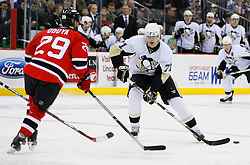 Dec 10, 2008; Newark, NJ, USA; Pittsburgh Penguins center Evgeni Malkin (71) makes a pass by New Jersey Devils defenseman Johnny Oduya (29) during the first period at the Prudential Center.