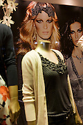 A model's face appearing to belong to a womens' fashion window mannequin in Chelsea.
