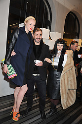 Left to right, GWENDOLINE CHRISTIE, DAVID WADDINGTON and PRINCESS JULIA at a party to celebrate the launch of a limited edition shoe The Chambord in celebration of Nicholas Kirkwood's partnership with Chambord black raspberry liqueur, held at the Nicholas Kirkwood Boutique, 5 Mount Street, London on 12th December 2012.