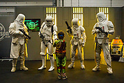 UNITED KINGDOM, London: 25 May 2018 Cosplay fans dressed as Storm Troopers meet a fan at the MCM London Comic-Con this afternoon. The three day comic convention, which is held at London's ExCeL, will see thousands of visitors many of them in cosplay, dressed as their favourite super hero, villain or comic book character. Rick Findler  / Story Picture Agency