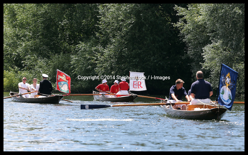 Image licensed to i-Images Picture Agency. 14/07/2014. Shepperton, United Kingdom. A flotilla of boats set off on  the Swan Upping, the annual census of the swan population on the river Thames .Picture by Stephen Lock / i-Images