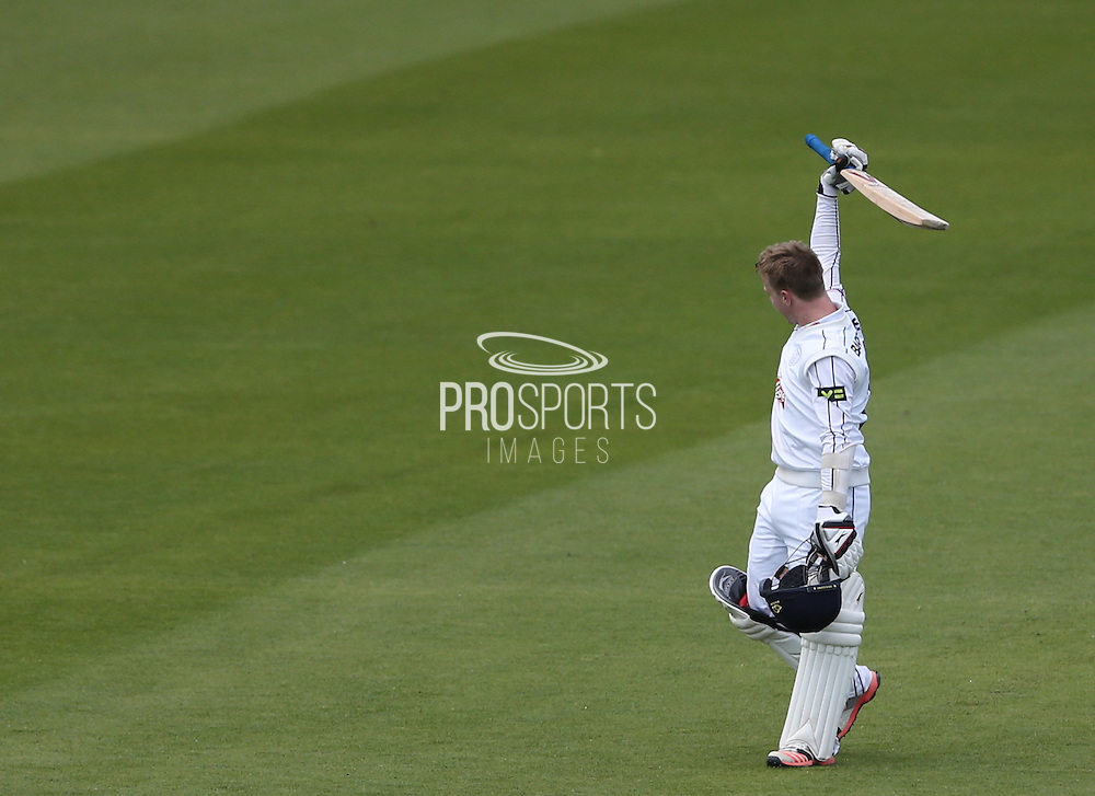Adam Wheater celebrates scoring a century  during the LV County Championship Div 1 match between Sussex County Cricket Club and Hampshire County Cricket Club at the BrightonandHoveJobs.com County Ground, Hove, United Kingdom on 8 June 2015.