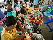 30 OCTOBER 2015 - YANGON, MYANMAR:  A watermelon vendor of the Dala Ferry. The ferry to Dala runs continuously through the day between Yangon and Dala. Yangon, Myanmar (Rangoon, Burma). Yangon, with a population of over five million, continues to be the country's largest city and the most important commercial center.          PHOTO BY JACK KURTZ
