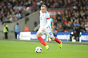 England forward, Wayne Rooney (10) dribbling during the Friendly International match between England and Portugal at Wembley Stadium, London, England on 2 June 2016. Photo by Matthew Redman.