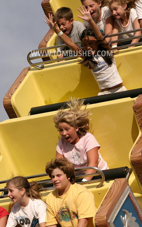 Children enjoy a high-flying ride at Fantasy Island amusement park in Beach Haven at Long Beach Island, N.J..Aug. 26, 2005........