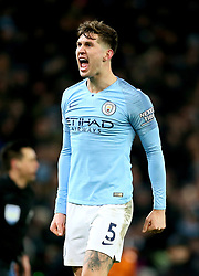 Manchester City's John Stones celebrates after the final whistle during the Premier League match at the Etihad Stadium, Manchester.