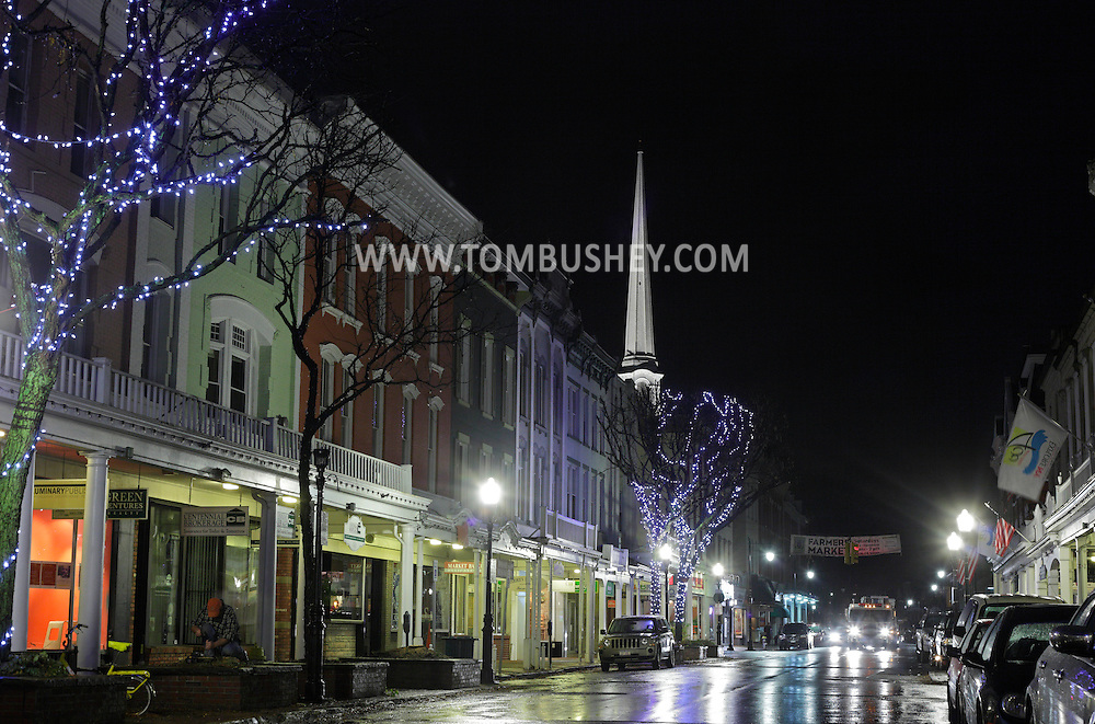 Kingston, NY - Trees are decorated with holiday lights in front of the stores on Wall Street on the evening of Nov. 14, 2009.