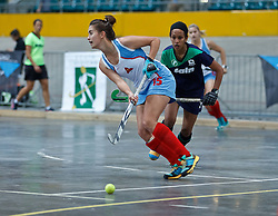 Teagan van der Wath of Western Province Peninsula passes under pressure from Amy Greaves of KZN Inland during the interprovincial indoor hockey tournament held at the Bellville Velodrome, Cape Town, on the 13th October 2016. Photo by: John Tee/RealTime Images