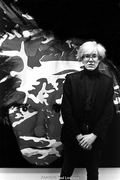 Andy Warhol with self portrait.