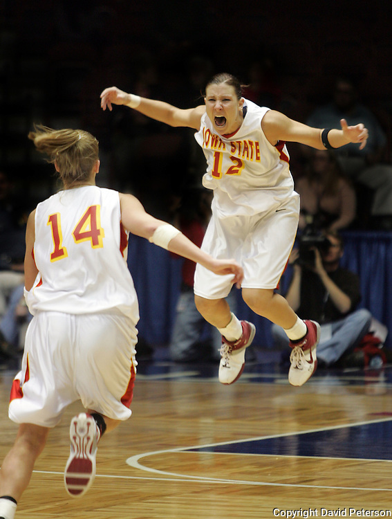 Anne O'Neil, right, guard for the Iowa State University women's basketball team, leaps for joy after a teammate hit the winning shot at the buzzer during the Big 12 Women's Basketball Tournament in Kansas City, Missouri, in 2005.