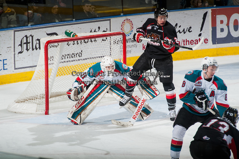 KELOWNA, CANADA - FEBRUARY 9: Jared Bethune #21 of Prince George Cougars gets tripped up in front of Jake Morrissey #31 of Kelowna Rockets as he defends the net  on February 9, 2015 at Prospera Place in Kelowna, British Columbia, Canada.  (Photo by Marissa Baecker/Shoot the Breeze)  *** Local Caption *** Jared Bethune; Jake Morrissey;