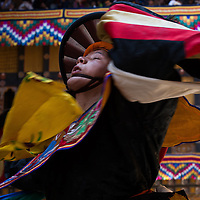 A boy dances in the Buddhist Paro Tshechu festival, the largest annual festival in Bhutan, and is part of the Black Hat Dancers. 2014