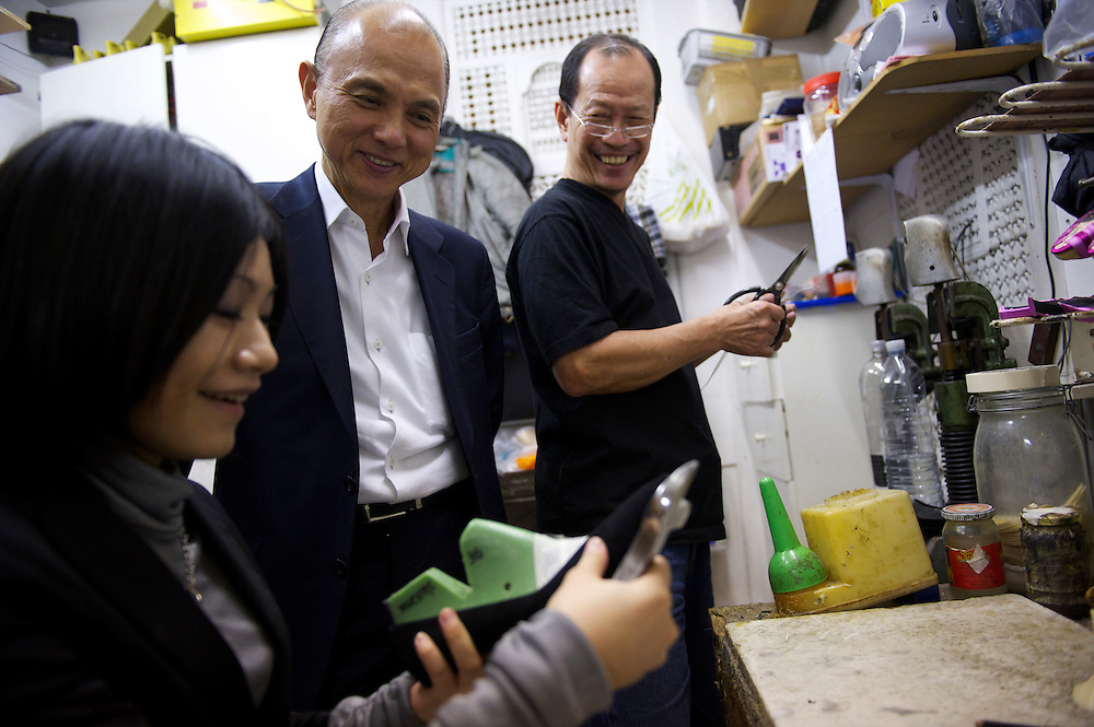 Fashion designer Jimmy Choo oversees work on a pair of bespoke shoes in his studio on Cannaught Street, London, March 22, 2010.
