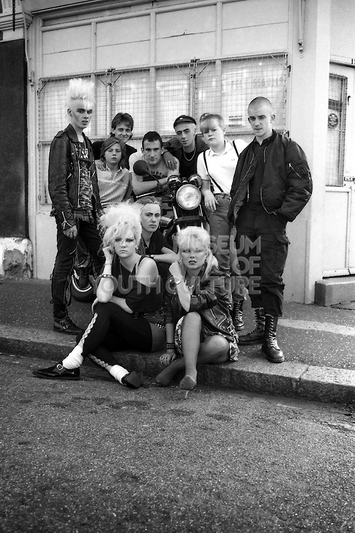 Group of Friends on the Kerb, High Wycombe, UK, 1980s.