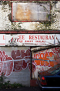 Derelict restaurant businesses left to decay on Toynbee Street, Tower Hamlets, East London.