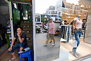 A variety of international brand name stores  can be found among the chic cafes, restaurants and bars that are becoming the norm in the once seedy district of Itaewon in Seoul, South Korea on 25 June 2010..Photographer: Rob Gilhooly