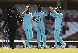 England's Jofra Archer (centre) and Moeen Ali (right) celebrate after taking the wicket of Afghanistan's Hazratullah Zazai during the ICC Cricket World Cup Warm up match at The Oval, London.