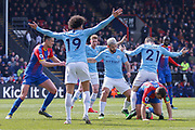 Manchester City midfielder David Silva (21) stands over Crystal Palace midfielder James McArthur (18) during the Premier League match between Crystal Palace and Manchester City at Selhurst Park, London, England on 14 April 2019.
