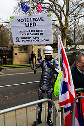 """""""Robocop"""" patrols the street, his poster accusing the Leave campaign of lying. London, January 14 2019."""